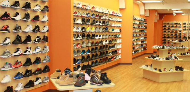 Shoe wall displays creative store solutions for Picture wall display